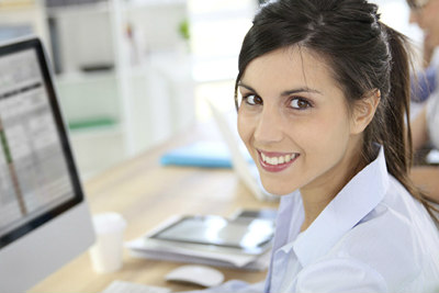 Dark-haired woman sitting at computer